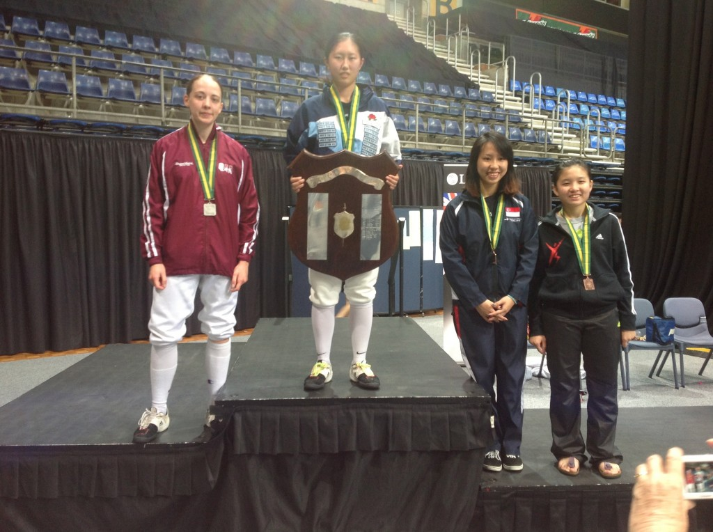 Lishan on the podium with the other medalists